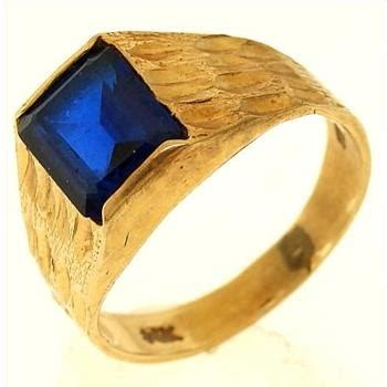 3 3 gram 14kt yellow gold ring with blue property