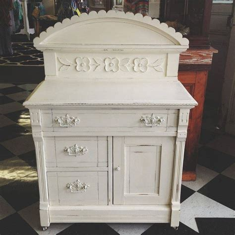 a unique small cabinet finished in old white chalk paint