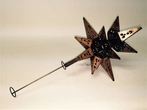 tin moravian star lighted tree topper copper finish