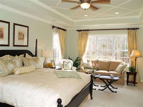 master bedroom master bedrooms with a sitting area sofa chairs chaise