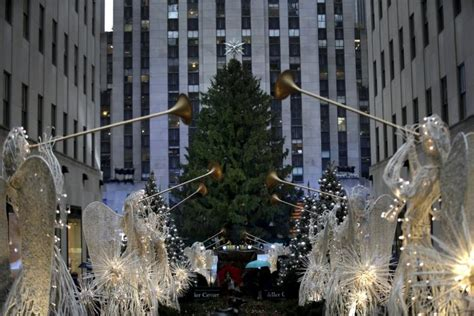 rockefeller center tree lights up amid rainy weather ny