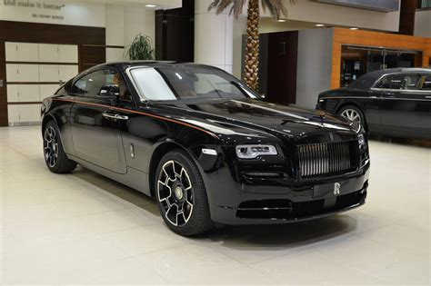 roll royce black rolls royce wraith black badge has a very orangy interior