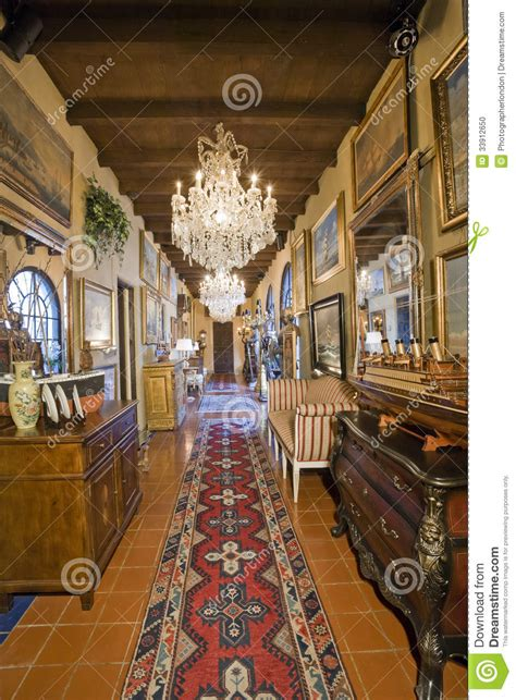 Armchair Antiques Hallway With Frames And Hanging Chandelier Stock Photo