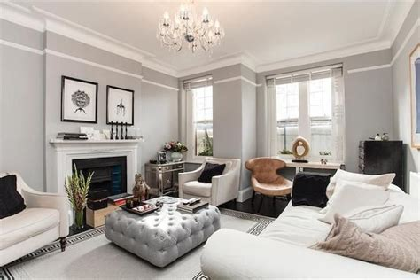 living room with picture rail grey and white living room home grey walls large ottoman and the white