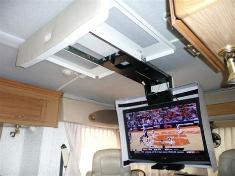 Rv Tv Ceiling Mount by Tvs Big Screen Tv And A Small On