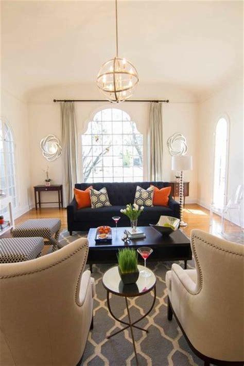 navy rug living room color story navy grey rug beige chairs pops of orange georgette westerman interiors