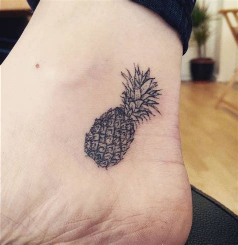 hand poked pineapple tattoo on the ankle tattoo artist