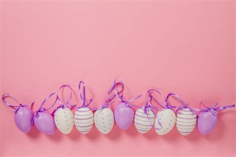 pink easter egg pink background with decorative easter eggs photo free