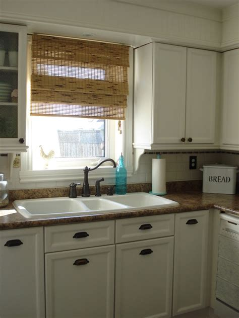 bright white kitchen with bronze hardware pictures to pin white kitchen traditional kitchen toronto by chris