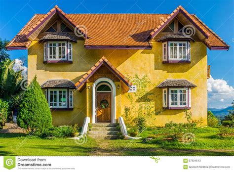 european style house front of vintage yellow european style house stock photo