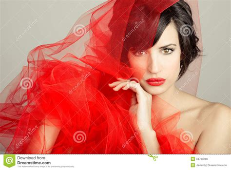 beautiful videos beautiful girl with a red tulle studio photograph stock