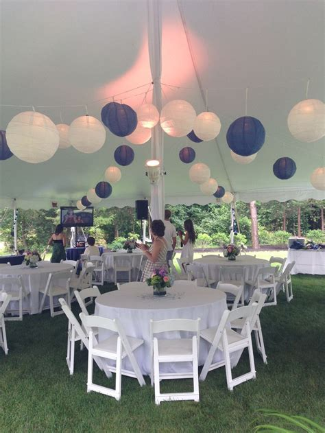 tented blue and white graduation backyard