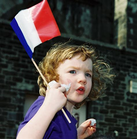 child in french bastille day child with french flag