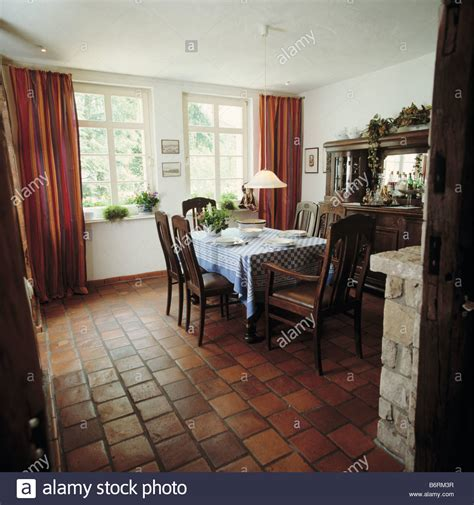 Country Dining Room Curtains Terracotta Tiled Floor In Country Dining Room With Curtains And Stock Photo Royalty Free