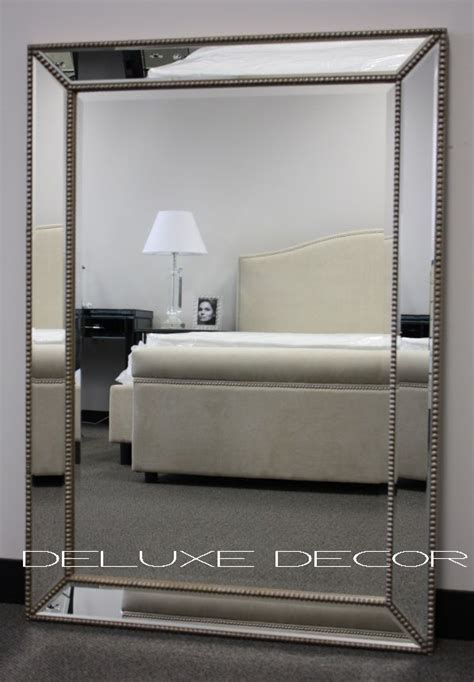 gold silver detail framed bevelled wall mirror