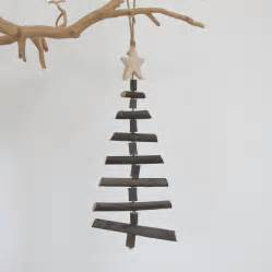 small wooden twig hanging christmas tree by chapel cards