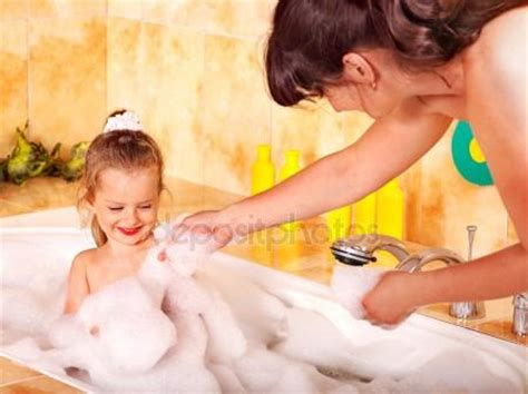my mom in the bathroom mother and daughter washing in bath stock photo