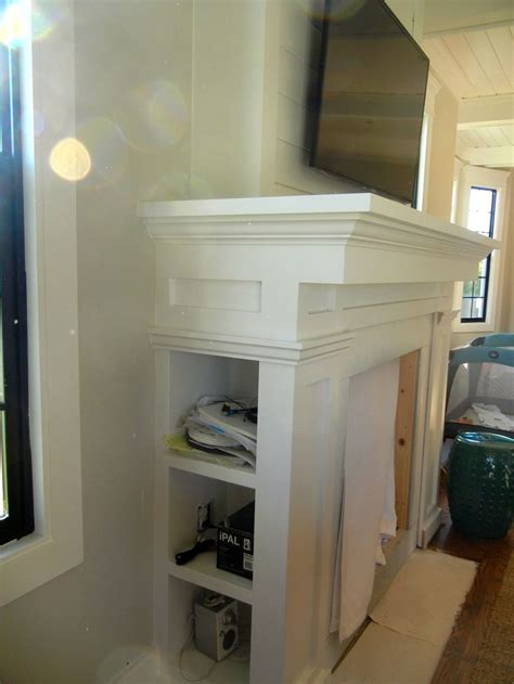 custom fireplace mantel with storage for media components