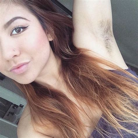 these photos of women with underarm hair are beautiful and hairy armpits is the latest women s trend on instagram