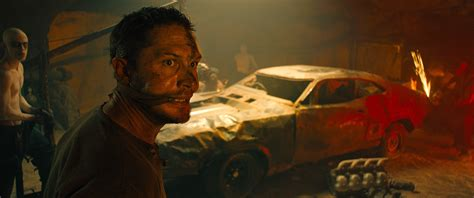 tom hardy gives mad max 40 new mad max fury road pictures feature tom hardy collider