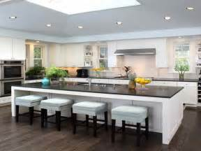 kitchen island with cooktop and seating a creative mom