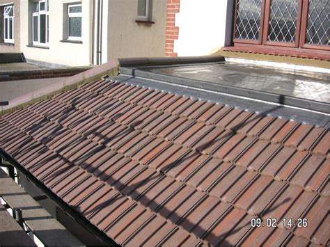 Roof To Roof New Crown Flat Roof With New Tiles Leadwork