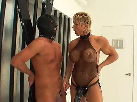 Muscle Woman Dominates A Guy And Fucks His Asshole