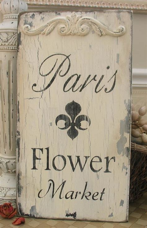 cafe de paris rustic french cottage style old wood wall paris flower market french market sign paris apartment