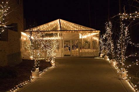 outdoor party tent lighting using sting lights to light pathways wedding tent