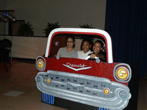 cars photo booth props and wooden car on