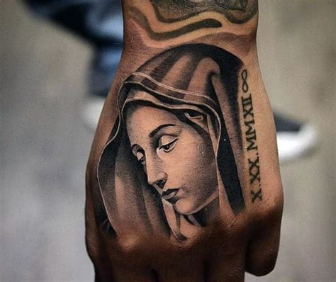 sad virgin mary religious memorial tattoo on hand with