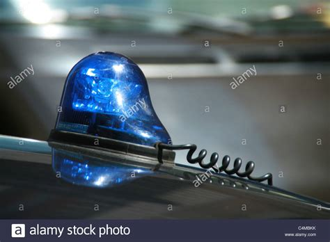blue light on car blue light on top of car roof stock photo royalty