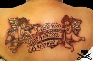 cross tattoo on shoulder blade cherub holding banner tattoo hautedraws