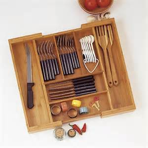 bamboo expandable flatware organizer in kitchen drawer