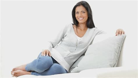 girl sitting on couch beautiful young woman sitting on the sofa at home relaxed