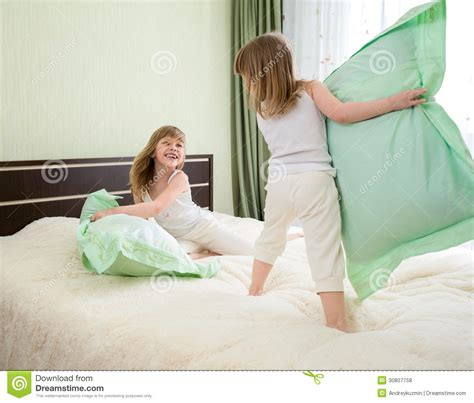 two pillows on bed stock photo image of domestic room two kids or children playing or have battle with pillows