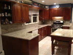 Granite Countertops With Cherry Cabinets Soothing River White Granite Countertops