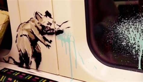 banksy artwork  london underground encourages mask