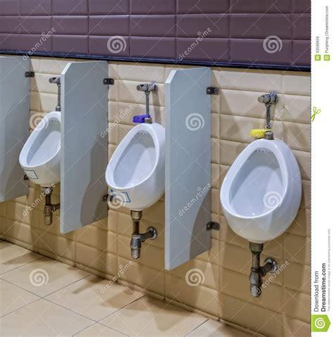 public bathroom men white ceramic urinals for men in public toilet room stock