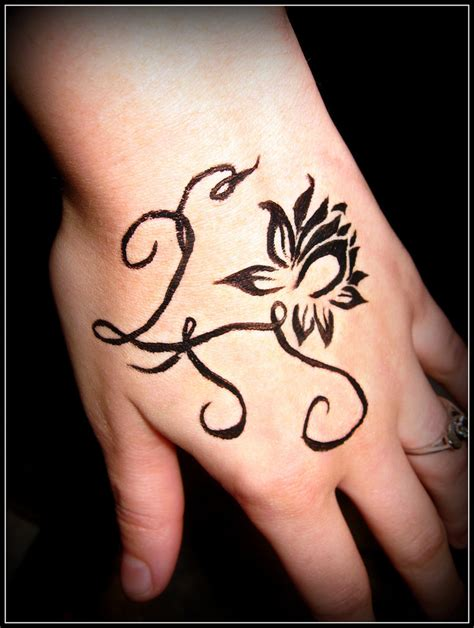 tattoo lotus hand hand tattoo picures images