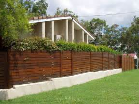 Kwila slat screen boundary fence sitting ontop of rendered block wall