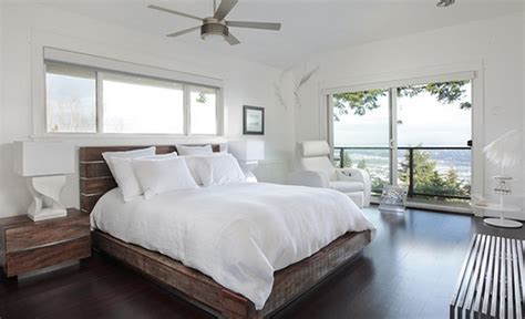 contemporary bedroom nuanced in cool white and equipped