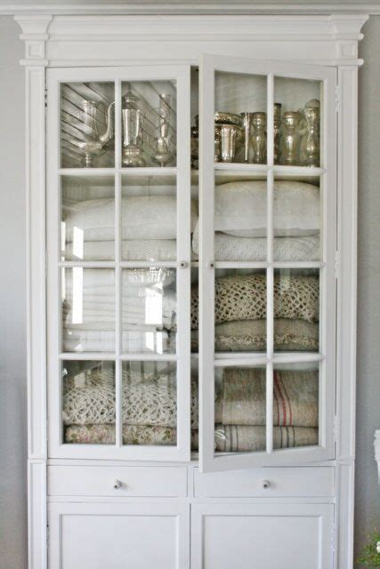 bathroom linen cabinet with glass doors vintage white cabinet with glass doors for linen storage