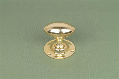pair of antique solid brass oval door knobs handles