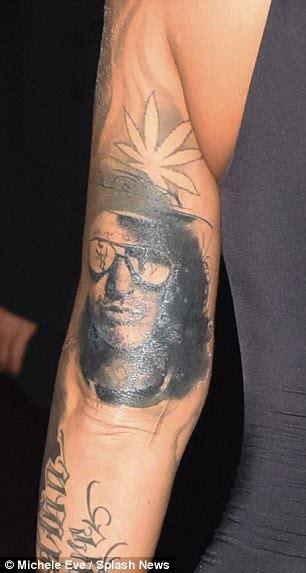 slash rose tattoo alters wiz khalifa to look like slash