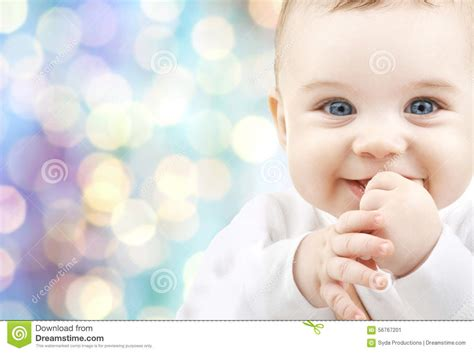 www baby happy baby over blue holidays lights background stock