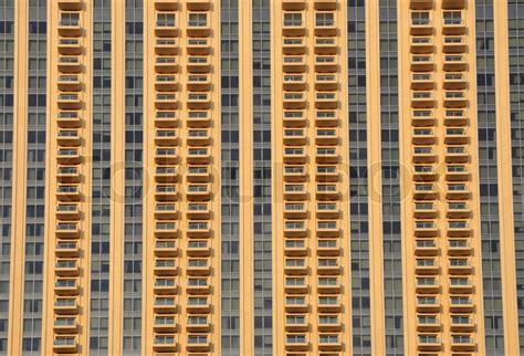 textured front facade modern box home facade of a modern residential apartment building stock