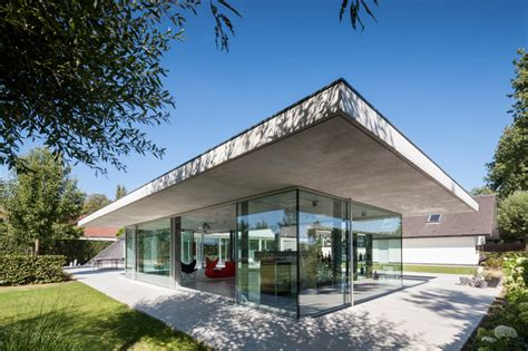 glass and concrete house lieven dejaeghere designs a glass and concrete pool house