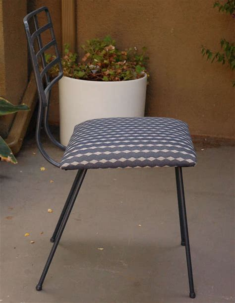 metal and glass outdoor dining table and four chairs at