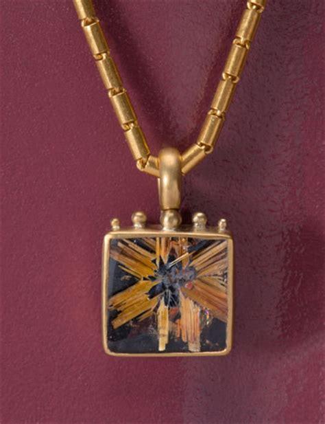 the golden eye rutilated quartz picture frame pendant